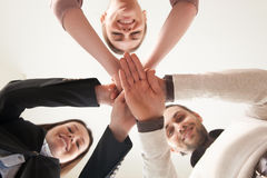 Successful united business team put hands together, view from be Stock Image