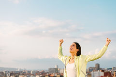 Successful urban athlete on outdoor exercising raising arms Royalty Free Stock Photography