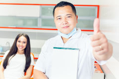 Successful visit patient to dentist doctor. Beautiful asian woman Royalty Free Stock Photos