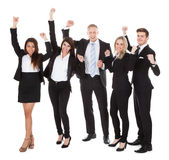 Successful Welldressed Businesspeople With Arms Raised Royalty Free Stock Image