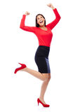 Successful winner business woman in red. Business Woman in red celebrating doing the Winner dance Royalty Free Stock Photography