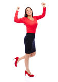 Successful winner business woman in red. Business Woman in red celebrating doing the Winner dance Stock Image