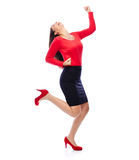Successful winner business woman in red. Business Woman in red celebrating doing the Winner dance Royalty Free Stock Photo