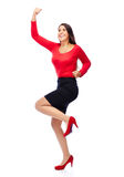 Successful winner business woman in red. Business Woman in red celebrating doing the Winner dance Royalty Free Stock Image