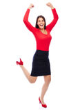 Successful winner business woman in red. Business Woman in red celebrating doing the Winner dance Royalty Free Stock Images