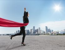 Successful winner businesswoman on the finishing line royalty free stock images