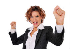 Successful Woman. Successful business woman in charge and excited, with her arms up in the air and her fists clenched, ready to take on any obstacle Stock Images
