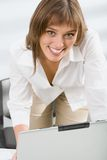 Successful woman. Portrait of successful young business woman smiling in the office royalty free stock photography