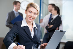Successful woman. Portrait of successful woman with wonderful smile on the background of business people stock photos