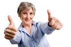 Successful woman. Image of successful aged woman showing thumbs up and looking at camera Royalty Free Stock Photography