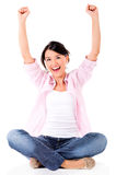 Successful woman with arms up Stock Photos
