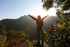 Successful Woman Backpacker Open Arms On Mountain Peak Royalty Free Stock Images