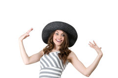Successful woman in a black hat has placed her hands in delight Stock Photos