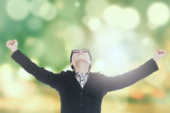 Successful woman with bokeh background Royalty Free Stock Image