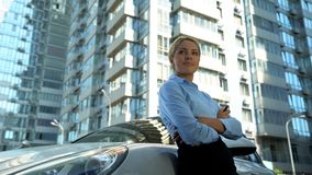 Successful woman buys luxury auto, turns on car alarm, nod of approval, wealth. Stock photo stock image