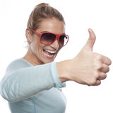 Successful woman. Close up portrait of successful woman showing thumbs up Stock Photos