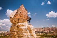 Successful woman Concept  motivation, inspiration. Successful climbing woman in Cappadocia mountains Concept of concept of motion motivation inspiration Stock Photo