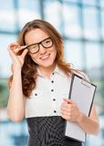 Successful woman corrects glasses royalty free stock image