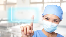 Successful woman doctor press empty button royalty free stock images