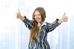 Successful woman doing thumbs up Stock Images
