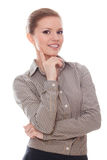 Successful woman with finger on her cheek Stock Photos