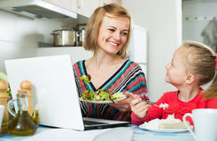 Successful woman with girl working from home Royalty Free Stock Photos