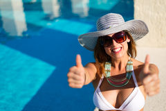 Successful woman having fun at poolside on summer vacation Stock Image