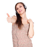 Successful woman with headphones and thumb up Stock Photography