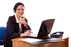 Successful Woman At Her Desktop Stock Images