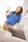 Successful woman with her tablet Stock Images