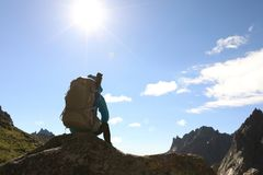 Woman hiker enjoy the view on the mountain top rock. Successful woman hiker enjoy the view on the mountain top rock Stock Images