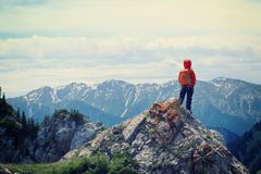 Woman hiker enjoy the view on mountain top rock. Successful woman hiker enjoy the view on mountain top rock Stock Photography