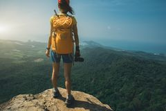 Woman hiker stand on mountain peak cliff edge. Successful woman hiker stand on mountain peak cliff edge Royalty Free Stock Images
