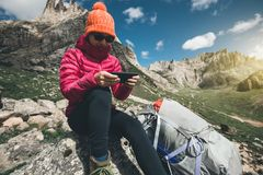 Woman hiker use smartphone in mountain top rock. Successful woman hiker use smartphone in mountain top rock Royalty Free Stock Photography