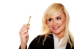 Successful woman holding brass key Royalty Free Stock Photos