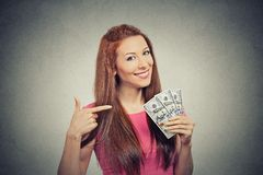 Successful woman holding showing money dollar bills Stock Photos