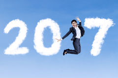 Successful woman jumps with 2017 Stock Photo
