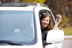Successful woman with keys from  car Stock Photos
