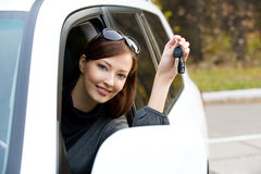 Successful woman with keys from  car Stock Photography