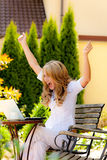 Successful woman with a laptop. Successful, smiling woman with a laptop in the garden Royalty Free Stock Images