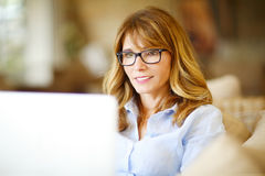 Successful woman with laptop Royalty Free Stock Photo