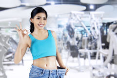 Successful woman lose weight at fitness center Royalty Free Stock Images