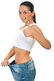 Successful woman loss weights. And giving thumb up isolated on white background Royalty Free Stock Image