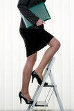 Successful woman makes career ladder Stock Photo
