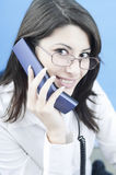 Successful woman on the phone. Young business woman doing business on the phone Royalty Free Stock Images