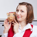 Successful woman with piggy bank on Stock Photo
