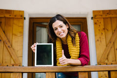 Successful woman showing digital tablet screen on autumn Stock Photo