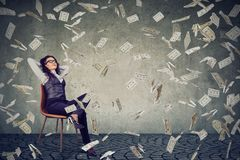 Successful woman sitting under money rain Royalty Free Stock Images