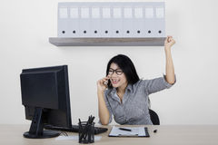 Successful woman with smartphone in workplace Stock Photography