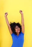 Successful woman smiling with arms outstretched Stock Photo